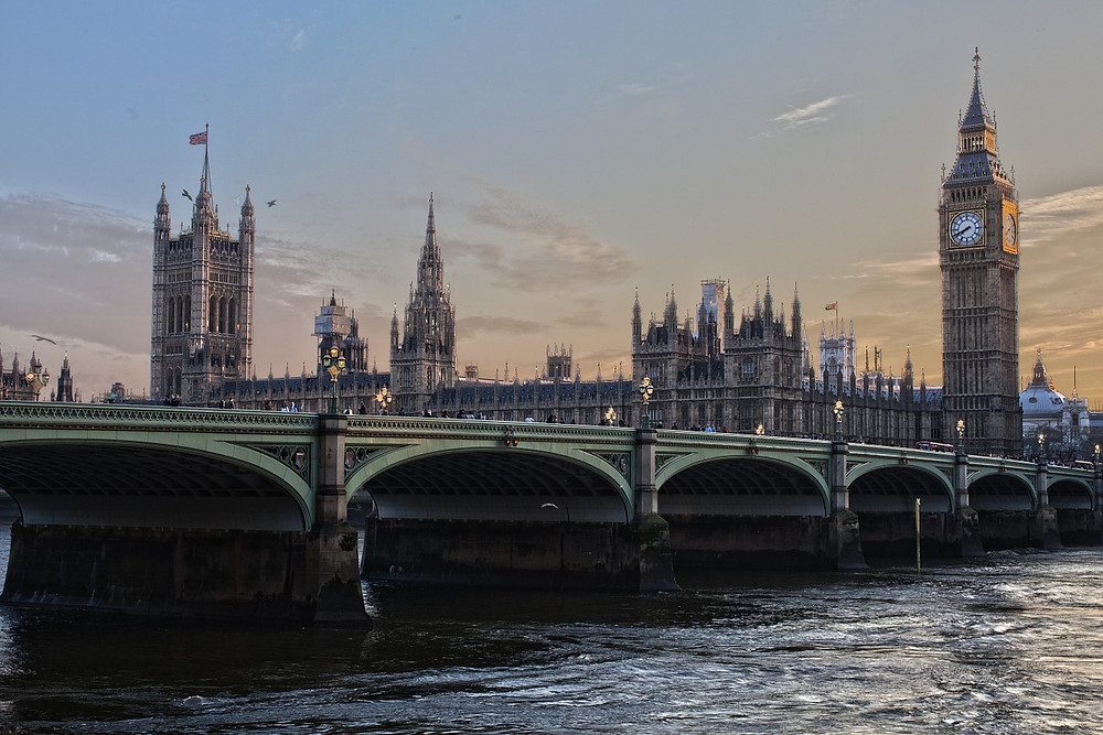 the palace of westminster and houses of parliament on the thames in london