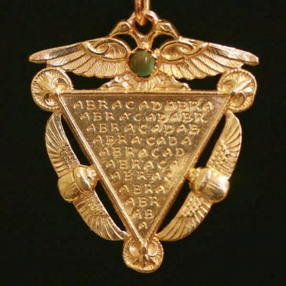 protective golden amulet bearing an inverted triangle of abracadabra
