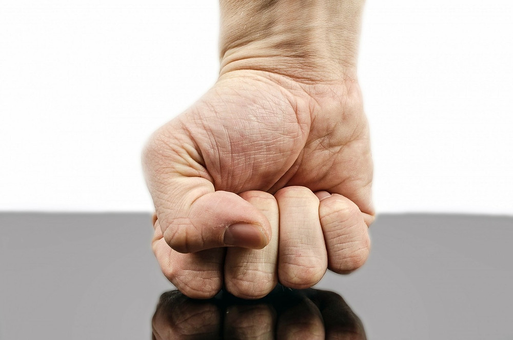clenched fist showing anger