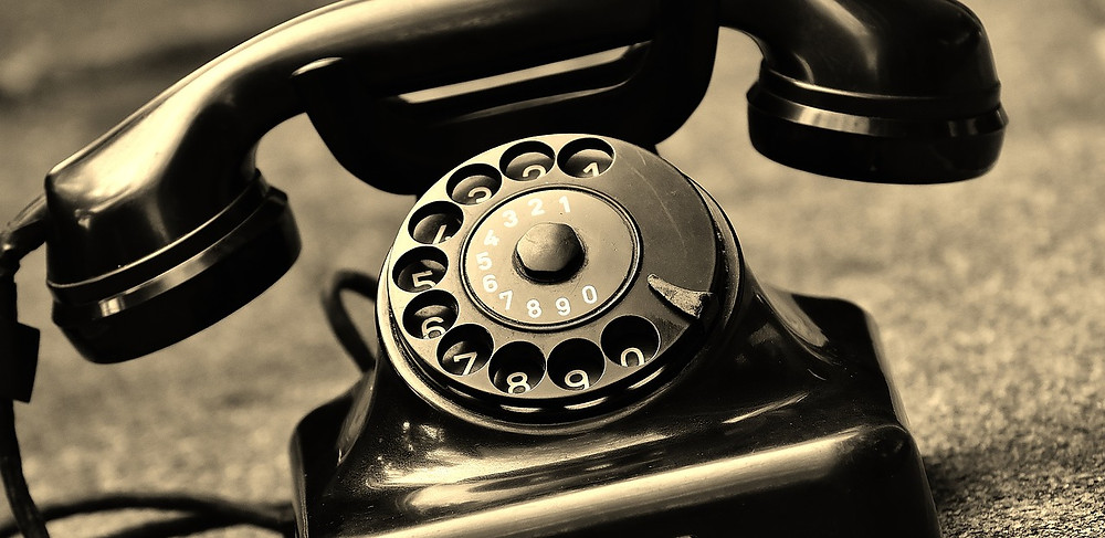 old fashioned black dial telephone