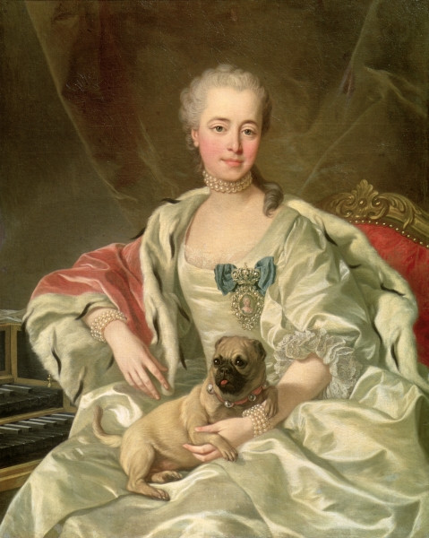 portrait of a woman holding her lapdog
