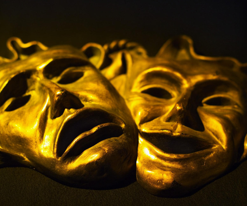 Dramatic masks of comedy and tragedy, origin of threnothriambic poetry