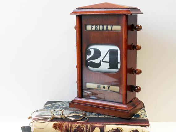 old style revolving paper desk calendar