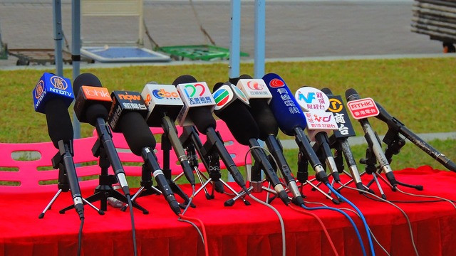 world microphones at a political news conference