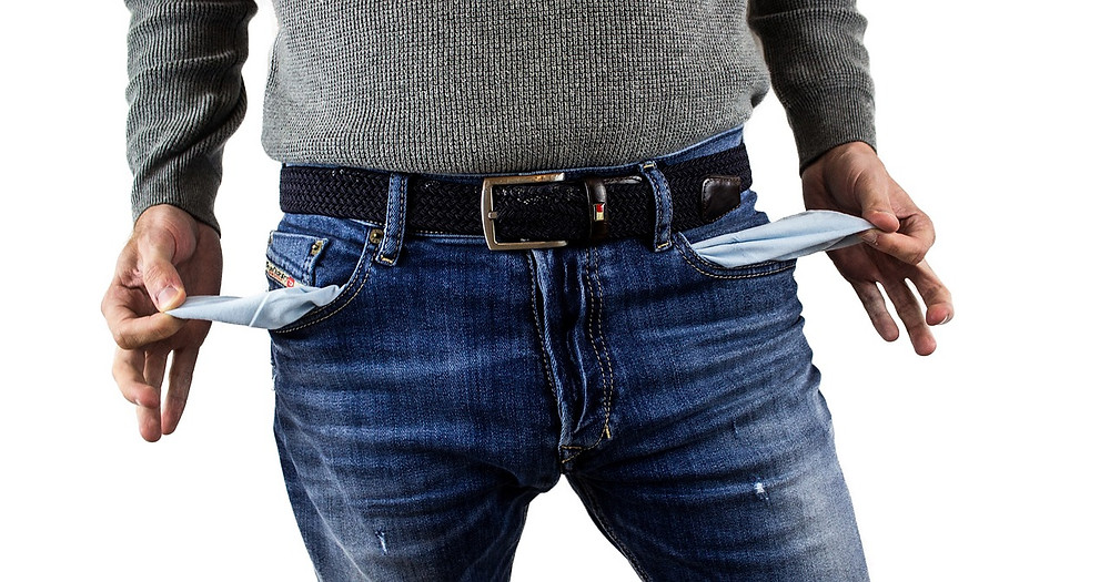 penniless man turning pockets inside out
