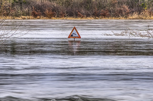 A flooded road with a roadsign, origin of apres moi le deluge