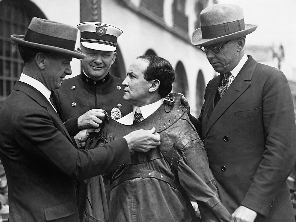 Harry Houdini has a straitjacket fitted in 1923