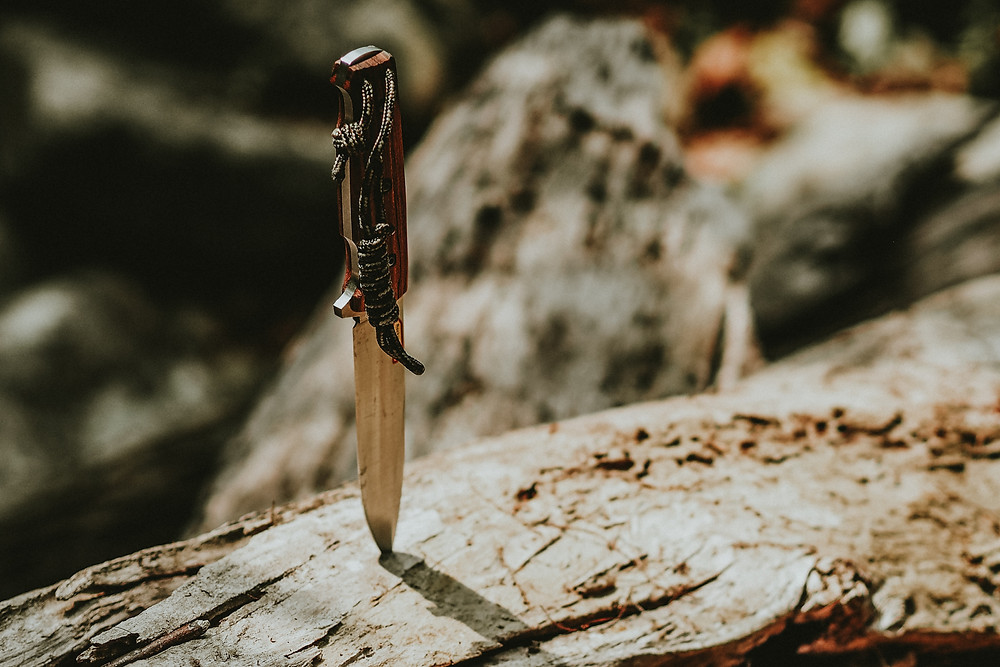 knife stabbed into timber