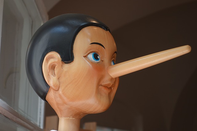 wooden model of pinocchio with long nose