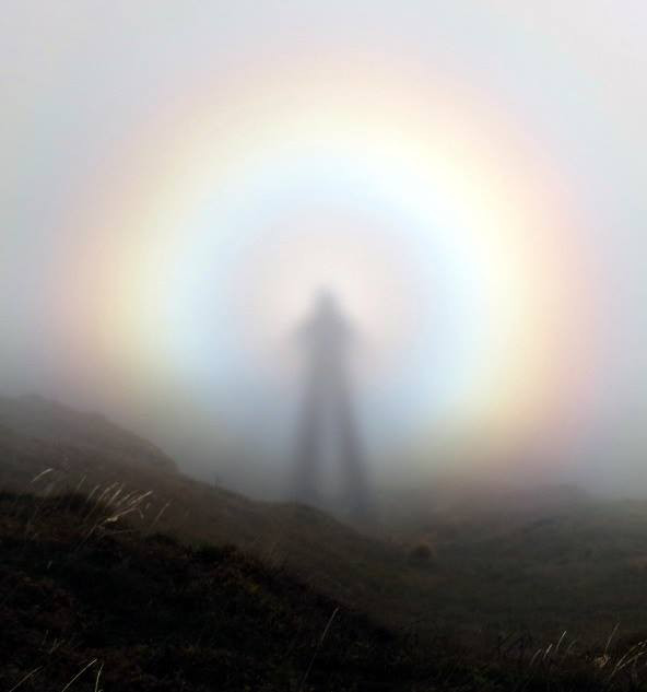 brocken specter rainbow projected against mist