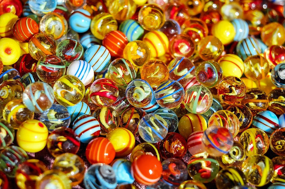 A pile of children's marbles of various colours