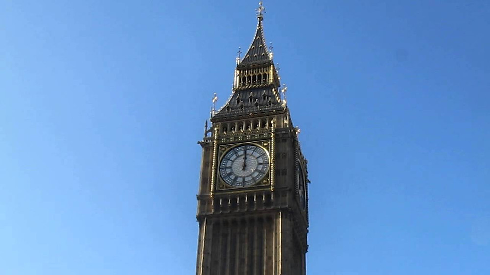 image of big ben tower in westminster showing 12 o'clock noon midday