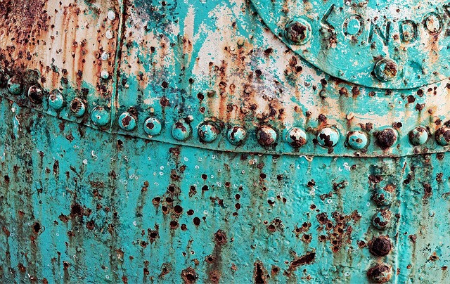rusted hull of a green ship