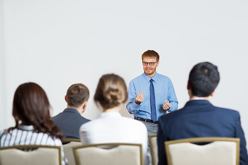 man-giving-lecture-audience.jpg