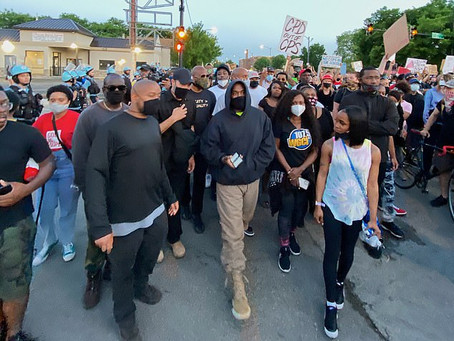 Kanye West joins protestors rallying against racial inequality and police brutality.