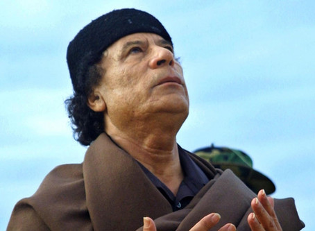 Gaddafi's prophecy comes true as foreign powers battle for Libya's oil.