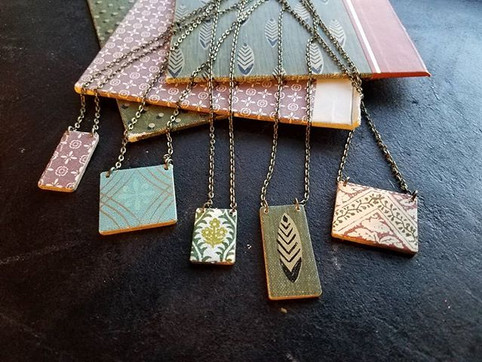 Necklaces made from old book covers