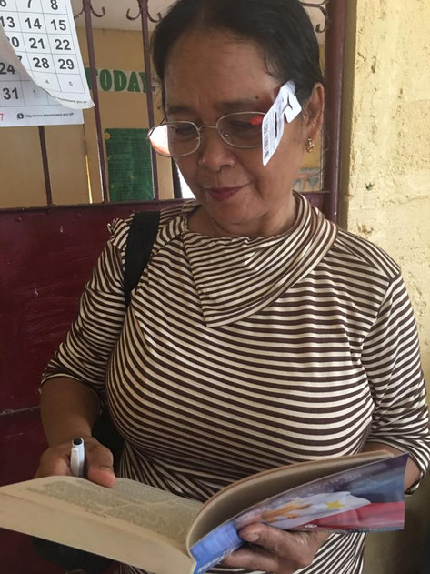 A woman tested her new eyeglasses reading her Bible