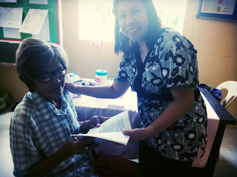Dr. Cora Flor ministering to patients