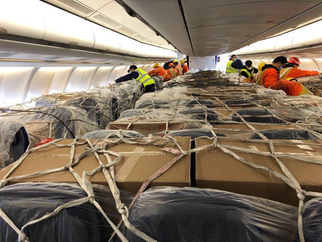Airlines are stuffing carton boxes between passenger seats