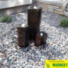 Basalt Pillar water feature with lightin