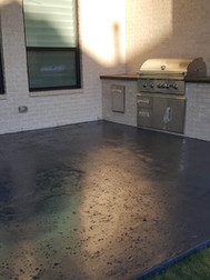 Patio was stained a dark grey and built in look grill installed to match the home.