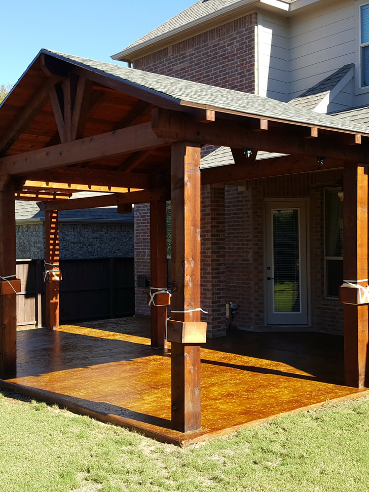 Concrete slab with salt finish and acid based stain to give marbled look.  Custom half patio cover, half pergola.