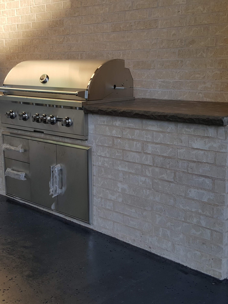 Built in grill to match the home with countertops stained to match the new floor.