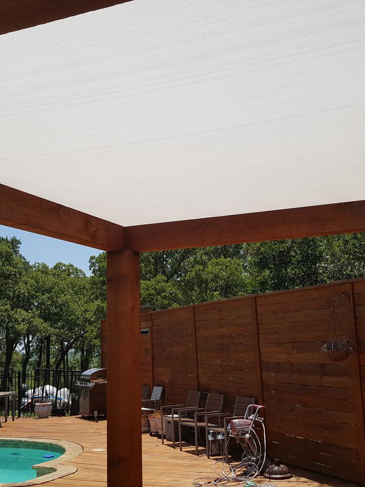 Pergola with fabric sun shade