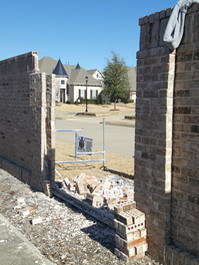 8' tall wall demolished by vehicle.