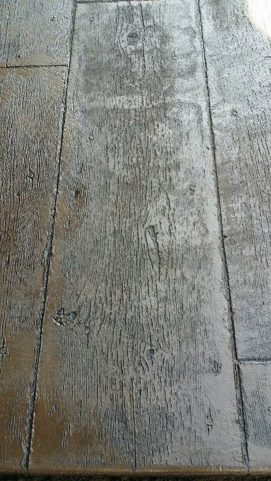 Wood patterned stamped concrete.