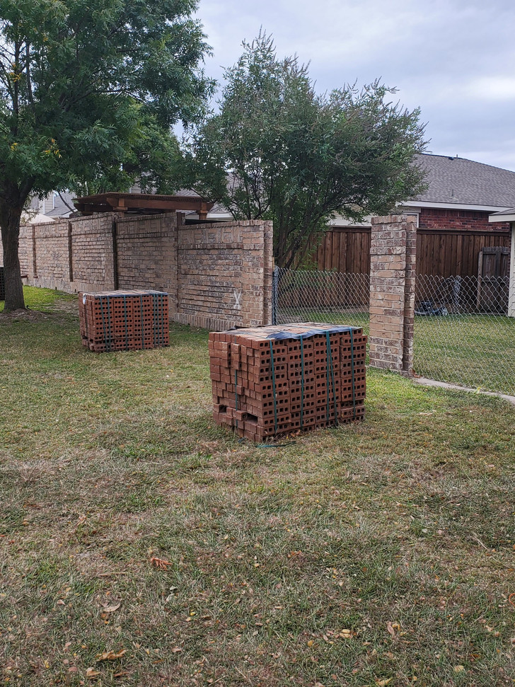 Brick fencing removed and prepared for installation of new bricks. Chain link temporary fencing is used when homes have pets, pools or if panels cannot be rebuilt in the same day.