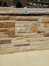 Custom shaped millsaps stone BBQ with custom flagstone countertops.