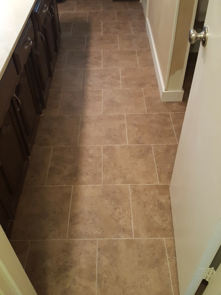 Floor tile was replaced to match the shower