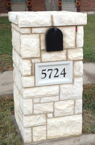Stone mailbox with address block