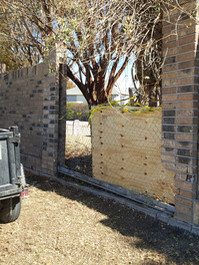 Vehicle crash cleaned up and temporary fencing installed while we waited for new matching brick to arrive.