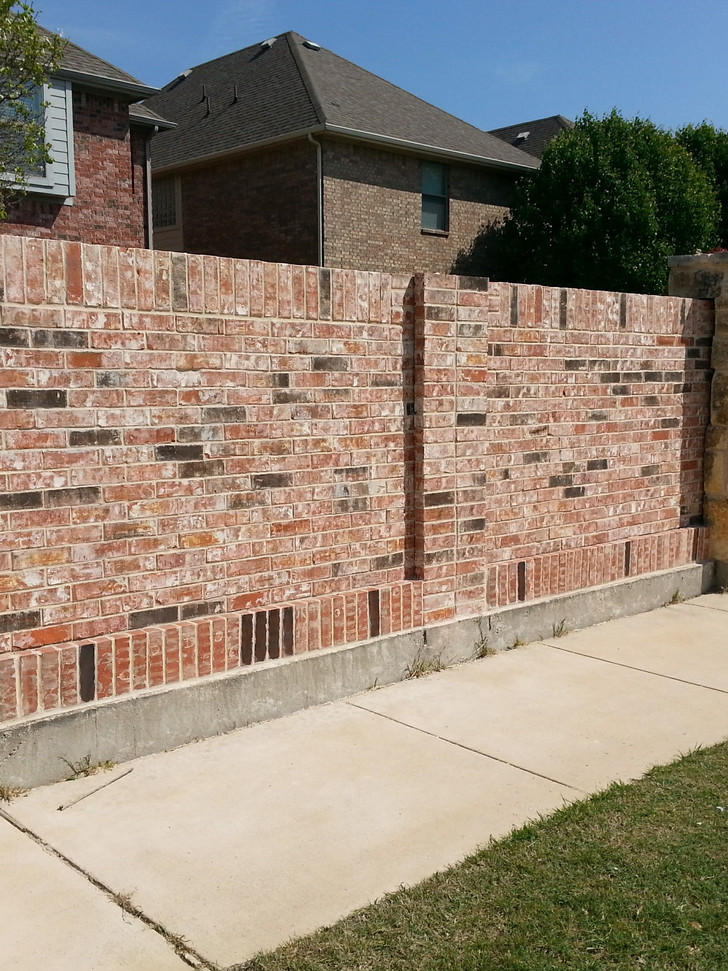 Screening Wall Completed. Brick was cleaned off and saved since this brick is no longer available.  New bricks were hand stained to match and blended in.