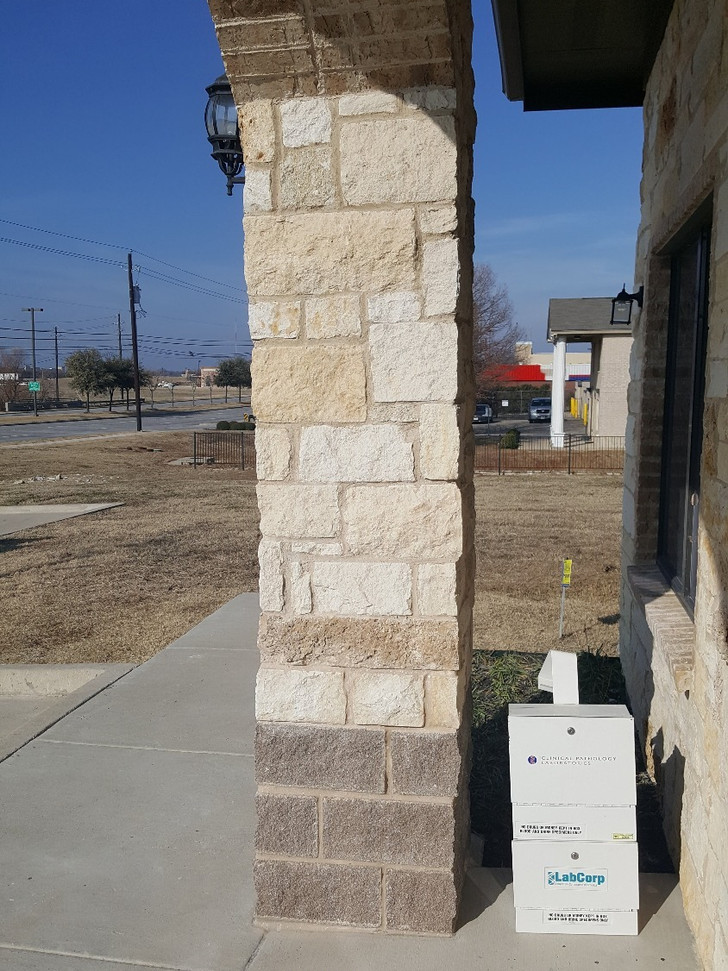 After replacing broken blocks with matching and blending mortar to a reasonable match.