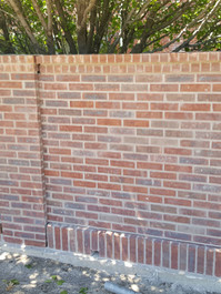 Fence panels and column rebuilt to match 35 year old wall.