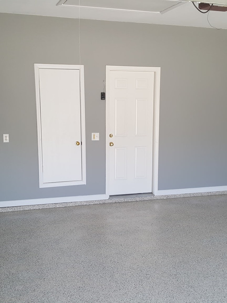 Epoxy floor coating and garage walls painted and trimmed out.