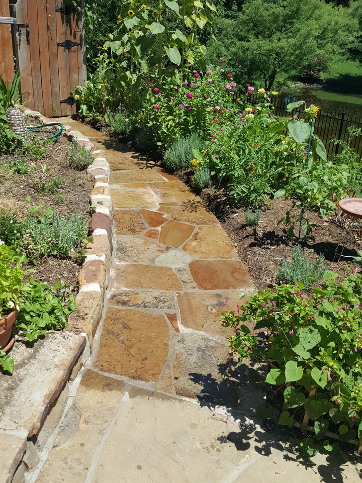 Flagstone sidewalk extension.  Stone is still wet from washing.  Always a great feeling knowing we matched the original stones perfectly.