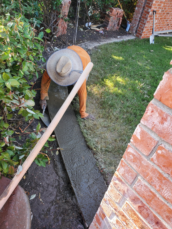 New concrete footing being poured using 3.000 psi concrete and rebar support.
