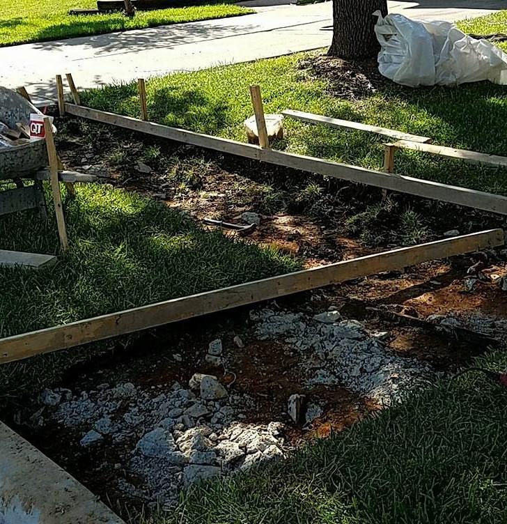 Original sidewalk has been hauled away and new is in progress