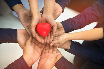 Group of hands holding red heart, health
