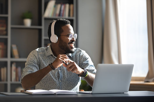 Happy relaxed millennial afro american business man wear wireless headphones look away res