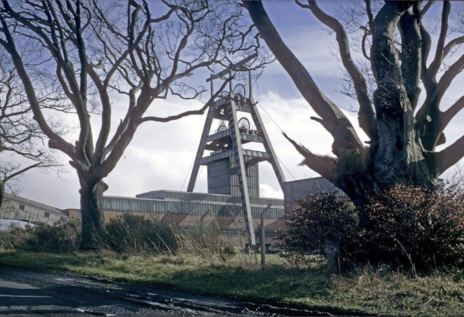 An image of Barony's A frame in winter with trees in the foreground
