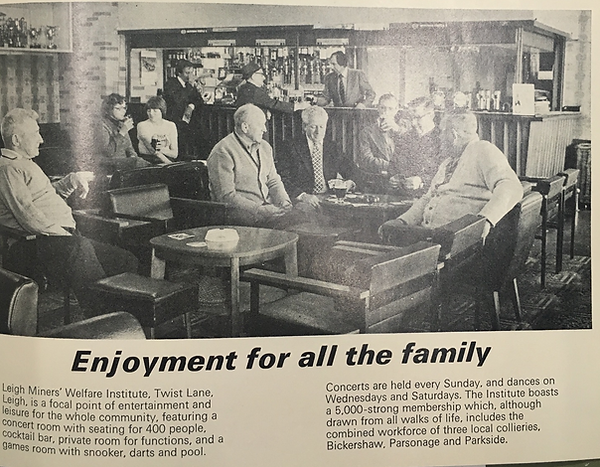 A printed page that contains a black and white image of Bickerhsaw miners welfare, indivdiuals sitting at he bar with a bar in the background. Text below is headed with 'Enjoyment for all the family'.