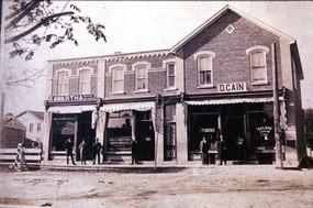 Woollard Drug Store, Bank of BNA, D. Cain Store