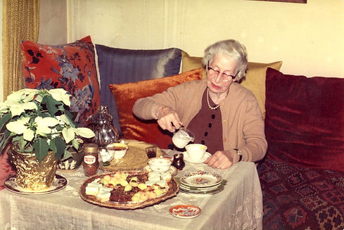 68 Miss Sheila's living room with her serving tea.jpg