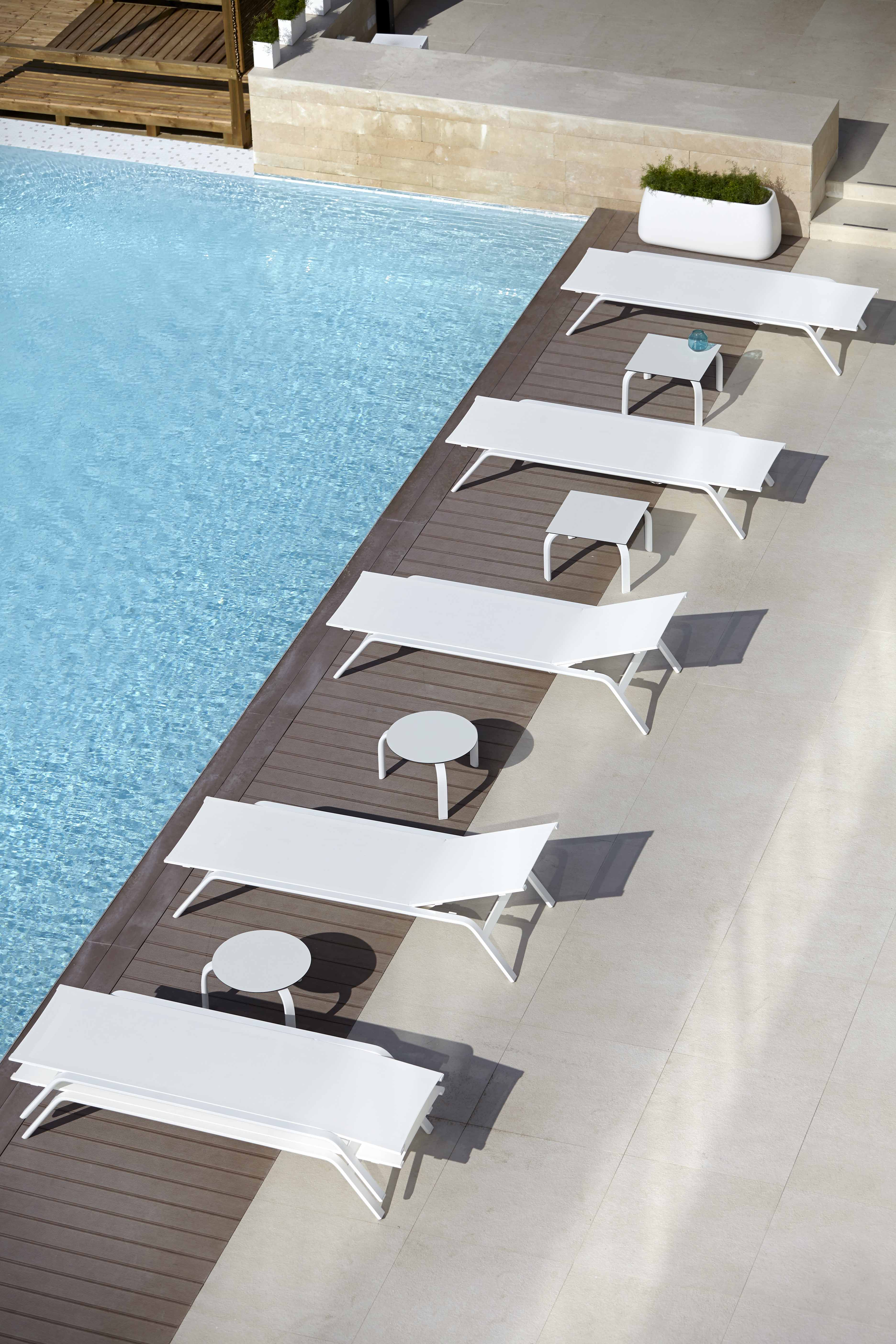 stack-chaiselongues-and-tables-for-chaiselongues-ambience-image